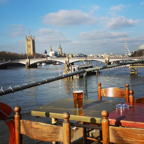 Enjoying a pint on the Thames with a view of Big Ben, Parliament and the London Eye.
